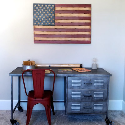 American flag wall art and industrial metal desk